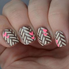 Wonderful looking white and mocha winter nail art design. The bold lines and the cute pink hearts complement each other giving a cute vibe f