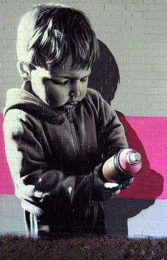 Young street artist on graffiti streetart