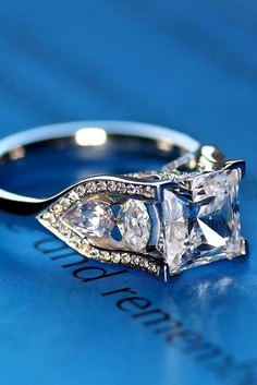 Look at our gallery with the best princess-cut engagement rings from popular designers that are known around the world.