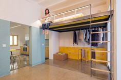Loft bed is a good option for rooms with high ceilings: G-ROC apartment in Barcelona