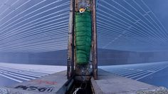 Explorer in a sleeping bag on top of a bridge. #photography