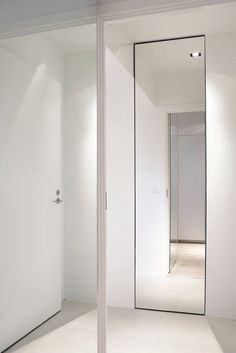 Hallway with tall mirror. Copenhagen Penthouse I by Norm.Architects. #hallway #mirror #normarchitects #minimalism