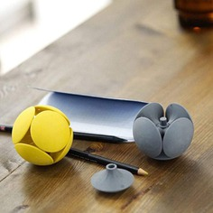 This modern Eraser Ball is a multi-functional tool and also a striking design object for your desk! It consists of six identical pieces that form a sphere when connected to its central axis. The ball also works as a cardholder while each eraser piece can be used as a pen holder. Each piece, including the axis, is carefully designed and crafted for making pinpoint erasures.