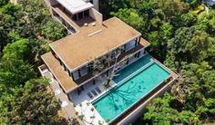 Presenting one of 5 bedroom Phuket's latest luxury villas, with impressive sweeping views overlooking the infinity pool and beyond out to Kamala beach. Book with Villa Getaways.