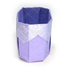 How to make a 3D origami paper cup II (http://www.origami-make.org/howto-origami-cup.php)