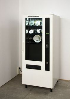 YARISAL & KUBLITZ. ANGER RELEASE MACHINE (2008) vending machine, porcelain, crystal glasses, plates, statuettes #machine #yarisal #installation #porcelain #vending #kublitz