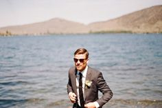 DIY Wedding Ideas | Wedding Blog | Used Wedding Dresses | Once Wed #wedding #sun #water #jacket #sunglasses #tie #landscape #brown #grey #blue #dapper #suit #mountains #green