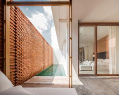 onion sala ayutthaya boutique hotel curved brick walls white geometries thailand designboom #pool