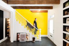 HISTORICAL ROW HOUSE GETS A WHIMSICAL, INDUSTRIAL RENOVATION