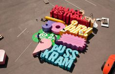 Cool 3D poster is made with letters so big that they can crush a human #type #big #wood #installation