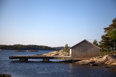 snøhetta reconstructs boat house on the shores of norwegian island #norway