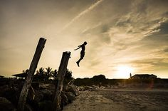 Leap of Faith - Chris DeLorenzo Photography #orange #jump #silhouette #heaven #leap #sunset #beach #life