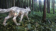 A Reflective Six Legged Wolf Covered in Mirror Shards by Tomoko Konoike #sculpture #art