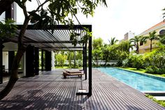 Green Villa with Clean Lines and Open Spaces wooden decking #outdoor #pool