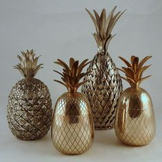 a group of 1960s large brass and silver metal pineapple ice buckets. #bucket #gold #art #pineapple #1960