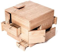 The Puzzle Cube is a wooden storage system that's perfect for organizing and storing important objects.