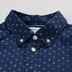 A cotton poplin shirt with a \'Flora\' discharge print design all over.   Norse Projects