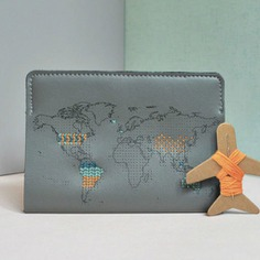 Stitch Passport Cover, Grey Mark every country you've been to with this Stitch Passport Cover. It is a real leather cover perforated in the shape of the world map, so every country visited can be marked with a cross.