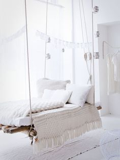 "CJWHO â""¢ (A rustic bedframe offsets the floaty white decor 