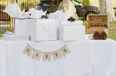 Although the wedding gift table is never at the top of any bride' tos -do list, that doesn't mean you can't have fun making it.
