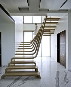 Sophisticated Indian Apartment with Woven Staircase central focal art point wooden staircase arabescato marble flooring