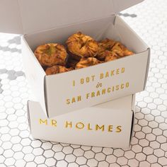 Stacked boxes for baked goods at Mr Holmes Bakehouse #packaging #design #box #type #foil #typography