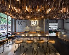 Shade Burger YOD studio interior design mindsparkle mag  concrete wall ceiling hanging wood industrial modern typography sign type design mi