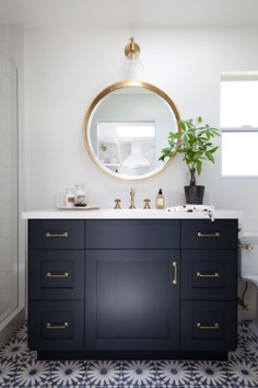 Image result for bathroom lighting above round mirror