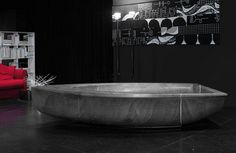 Art bathtub in grey grey color with form of boat sculpture
