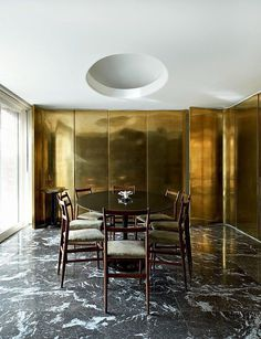 Dining room by Gio Ponti with brass wall panels #interior #architecture #brass #marble