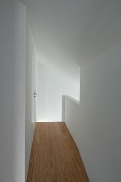 Two Houses in Largo do Trovador by Pitagoras Group. #pitagorasgroup #minimalism #hallway