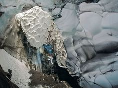 Picture of a climber in an ice cave in Antarctica