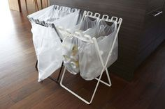 Organize your garbage and recycling with this foldable stand. #product #design #recycling #industrial