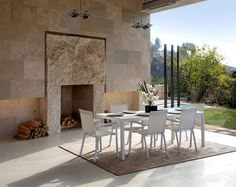 Californian House Encased in Beautiful Travertine Stone - #outdoor, outdoor, #dining, Dining Area, #chairs, #fireplace