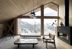 Trendy Alpine Cottage by Studio Razavi - InteriorZine