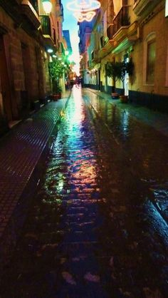 Cadizzle 2011 on Behance #spain #lights #cadiz #rain #reflection #colour