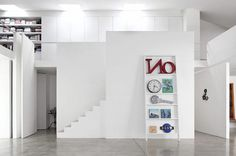 The Photographer's Studio Lo Spazio | Miss Design #interior #letters #white #bookshelves #design #decor #studio #walls