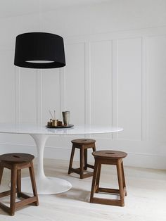 Dining area with Saarinen Oval Dining Table. Fulham House by Daniel Lee. #diningroom #minimal