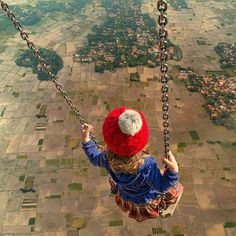 Surreal Photo Manipulations by Caras Ionut #photography #photo manipulation #aerial #child #earth #swing