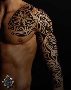 Polynesian maori full sleeve and chest plate tattoo