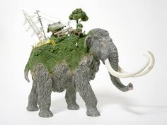 Toy Mammals and Dinosaurs Burdened with Miniature Civilizations by Maico Akiba toys sculpture miniature dioramas #sculpture #tusk #mammoth #mammal #elephant #juxtapositon #back #civilisation #miniature