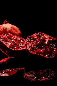 Juicy Pomegranate by Niermala B. Timmers www.niermalatimmers.com #drama #timmers #red #pomegranate #juicy #photo #fruit #bouwina #contrast #black #mirror #shiney #photography #healthy #niermala #hard #lighting #still #life #shadow