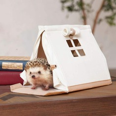 This Pet House Carry Bag is the perfect size for a pet hedgehog or hamster! Made from waterproof canvas, it resembles a cute tent complete with a tiny window so you can check on your furry friend anytime. It comes with a removable and washable plate for easy cleaning and maintenance, and a removable shoulder strap for hands-free transportation to vet visits or fun outings!