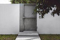 Perforated metal door. Doblado House by Isauro Huizar Studio. © 1826 Proyectos Fotográficos. #door