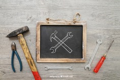 Chalkboard and tools Free Psd. See more inspiration related to Mockup, Blackboard, Chalkboard, Mock up, Tools, Hammer, Wrench, Up, Male, Screwdriver, Objects, Things, Composition, Mock, Pliers and Masculine on Freepik.