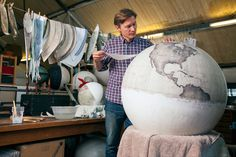 painting a globe.