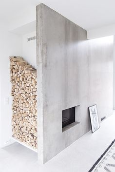 Fireplace and firewood niche. Home of Marja Wickman. #fireplace #niche #concrete