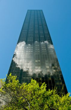 This photo is part of series of pictures taken during a visit to New York in May 2014 #vertigo #cloud #height #city #metropolis #glass #skyscraper #photography #architecture #building #reflection