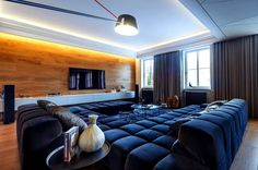Trendy and Unique Bachelors Nest heavy dark drapery artistic outlook decor #interior #design #living #room