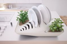 Fluidity: Dish Drying Rack - IPPINKA This dish drying rack design allows the water to systematically trickle downwards to the two plant con